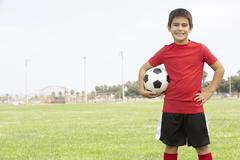 Stock Photo of Young Boy In Football Team
