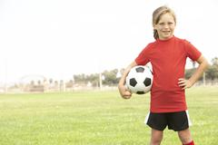 Young Girl In Football Team Stock Photos