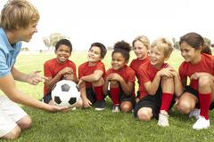 Young Boys And Girls In Football Team  With Coach Stock Photos