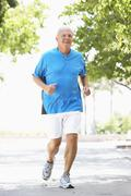 Senior Man Jogging In Park - stock photo