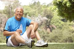 Senior Man Relaxing After Exercise Stock Photos