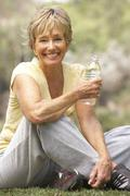 Senior Woman Relaxing After Exercise Stock Photos