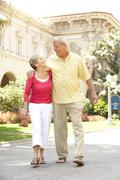 Senior Couple Walking Through City Street Stock Photos