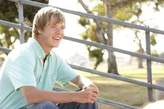 Teenage Boy Sitting On Steps - stock photo