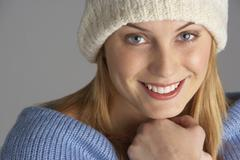 Portrait Of Pretty Young Woman Dressed For Winter Stock Photos
