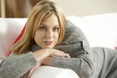 Young Woman Relaxing At Home Stock Photos