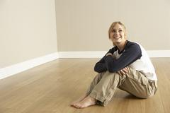 Young Woman Moving Into New Home Stock Photos