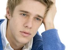 Head And Shoulders Of Thoughtful Young Man Stock Photos