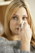 Young Woman With Cold Blowing Nose - stock photo