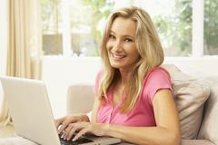 Young Woman Using Laptop At Home - stock photo