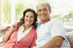 Senior Couple Relaxing At Home Stock Photos