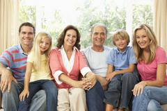 Extended Family Relaxing At Home Together - stock photo