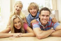 Family Having Fun At Home Together Stock Photos
