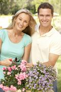 Young Couple Gardening - stock photo