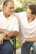 Senior Man Having Serious Conversation Adult Son - stock photo