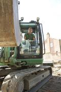 Construction Worker Using Digger - stock photo