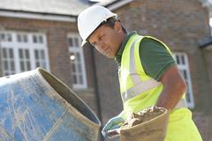 Construction Worker Mixing Cement Stock Photos