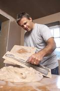 Stock Photo of Plasterer Mixing Plaster