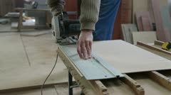 Carpenter cutting wood panel Stock Footage