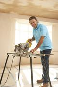 Builder Using Electric Saw Stock Photos