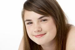Studio Portrait Of Happy Teenage Girl - stock photo