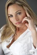Studio Portrait Of Woman Wearing White Shirt Stock Photos