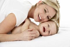 Studio Portrait Of Mother With Young Baby Boy - stock photo