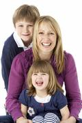 Mother With 2 Young Children In Studio - stock photo