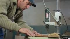 Drilling a hole Stock Footage