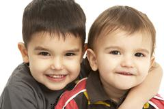 Studio Portrait Of Young Brothers - stock photo