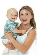 Studio Portrait Of Mother Holding Son - stock photo