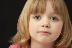 Close Up Studio Portrait Of Sad Young Girl - stock photo