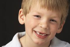 Studio Portrait Of Smiling Boy - stock photo
