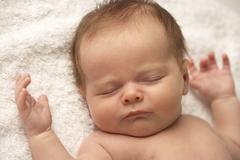 Close Up Of Baby Sleeping On Towel Stock Photos