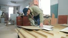 Carpenter cutting wood panel Stock Footage