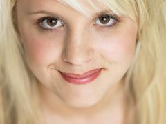 Close Studio Portrait Of Blonde Teenage Girl - stock photo