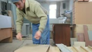 Furniture maker cutting wood panel Stock Footage
