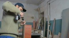 Screwing furniture Stock Footage