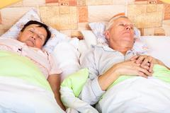 senior man and woman sleeping - stock photo