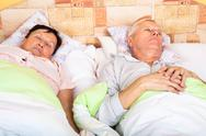 Stock Photo of senior man and woman sleeping