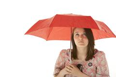 Studio Shot Of Teenage Girl Standing Under Red Umbrella Stock Photos