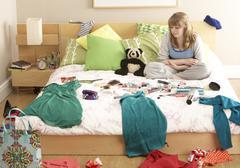 Teenage Girl In Untidy Bedroom - stock photo
