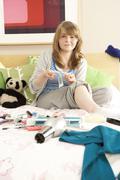 Teenage Girl In Untidy Bedroom Waxing Legs Stock Photos