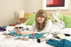 Teenage Girl In Untidy Bedroom Painting Nails Stock Photos