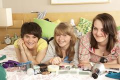 Group Of Teenage Girls In Untidy Bedroom - stock photo