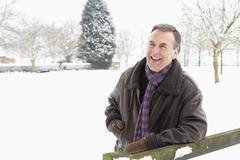 Senior Man Standing Outside In Snowy Landscape - stock photo
