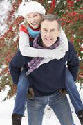 Senior Couple Outside In Snowy Landscape Stock Photos