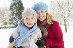 Mother And Son Standing Outside In Snowy Landscape - stock photo