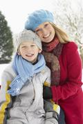 Mother And Son Standing Outside In Snowy Landscape Stock Photos