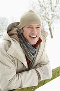 Man Standing Outside In Snowy Landscape - stock photo